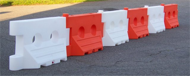 Water filled barricade orange jersey barrier